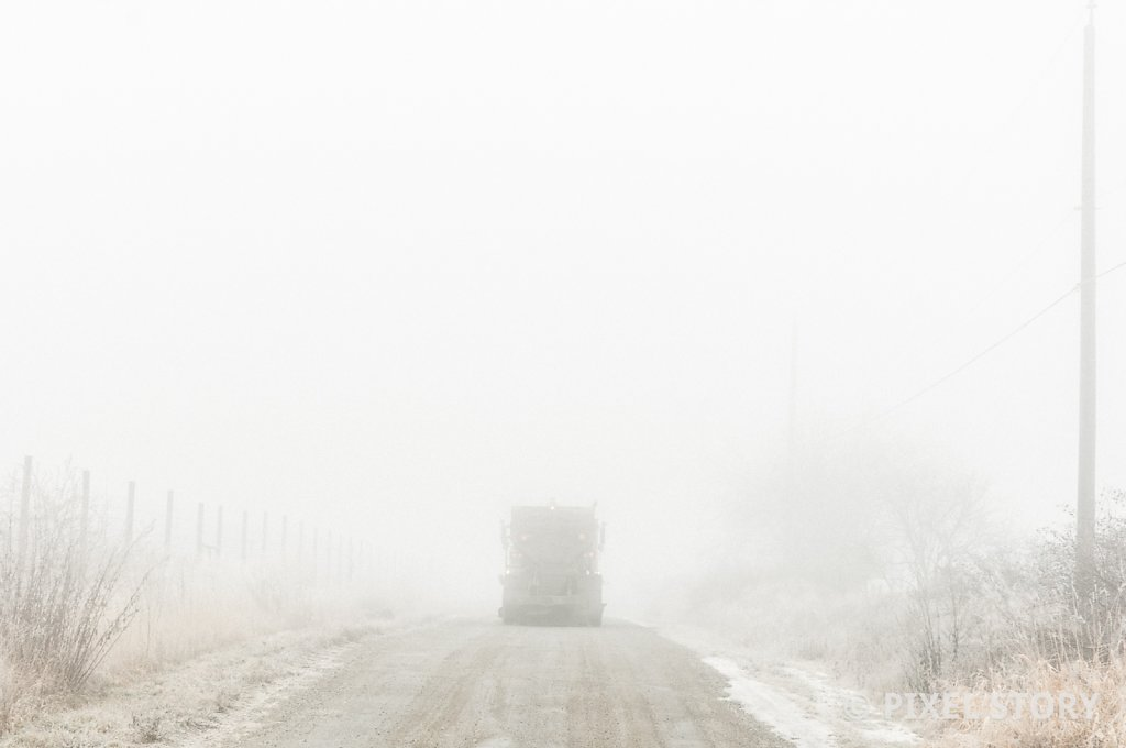 Road truck into the fog